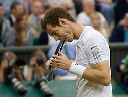 30.06.2014, All England Lawn Tennis Club, London, ENG, ATP Tour, Wimbledon, im Bild Andy Murray (GBR) takes a leaf out of Luis Suarez's book and bites his racquet during the Gentlemen's Singles 4th Round match on day seven // 15065000 during the Wimbledon Championships at the All England Lawn Tennis Club in London, Great Britain on 2014/06/30. EXPA Pictures © 2014, PhotoCredit: EXPA/ Propagandaphoto/ David Rawcliffe<br /> <br /> *****ATTENTION - OUT of ENG, GBR*****