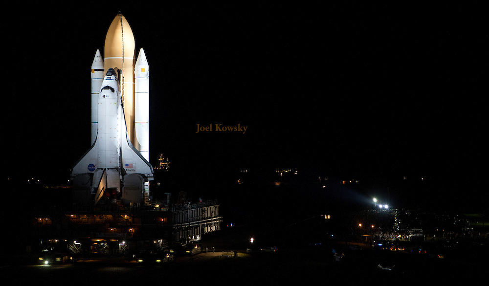 Cape Canaveral, Florida US - Space shuttle Atlantis departs the Vehicle Assembly Building for Pad 39A on Tuesday, May 31, 2011 for the final mission of the space shuttle program.  Atlantis is set to rocket into space on the programs final flight on July 8, 2011.