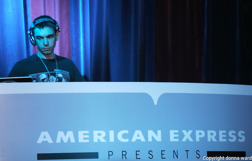 DJ AM spins at the private American Express presents Kanye West event at the Nokia Theater in Times Square on Tuesday, August 29, 2006 in New York.