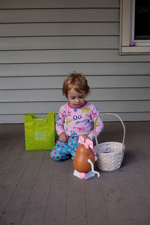 Madelyn Avery Eich, 2, inspects a Mr. Potato Head Easter bunny hidden by her mother on Easter Sunday, April 4, 2010 in her home in Norfolk, Virginia.