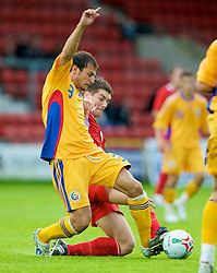 WREXHAM, WALES - Wednesday, August 20, 2008: Wales' Sam Vokes in action against Romania's Stefan Radu during the UEFA Under 21 European Championship Qualifying Group 10 match at the Racecourse Ground. (Photo by David Rawcliffe/Propaganda)