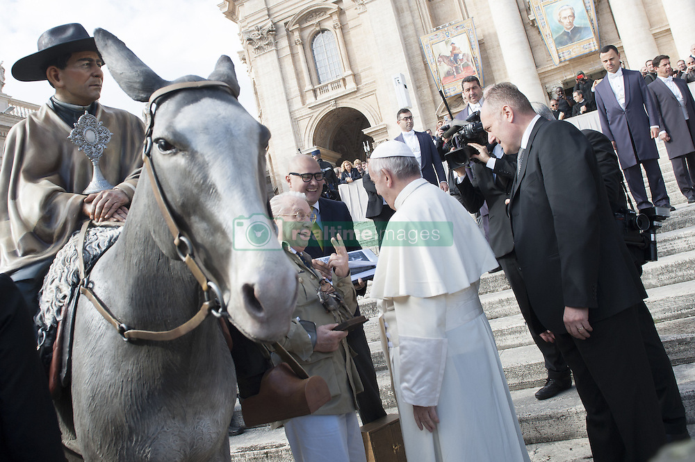 October 19, 2016 - Vatican City, Vatican - Pope Francis greets a man near a statue of Argentine Saint Jose Gabriel del Rosario at the end of his weekly general audience, in St. Peter's Square, at the Vatican, Wednesday, Oct. 19, 2016. Francis canonized Argentina's ''gaucho priest'' last Sunday, bestowing sainthood on the poncho-wearing pastor with whom the first Argentine pope shares many similarities. (Credit Image: © Massimo Valicchia/NurPhoto via ZUMA Press)
