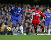 Photo: Lee Earle.<br /> Chelsea v Middlesbrough. The Barclays Premiership.<br /> 03/12/2005. Chelsea's Michael Essien (L) gets away from Jimmy Floyd Hasselbaink.