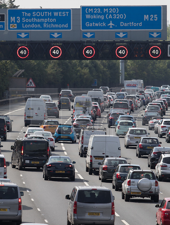 © Licensed to London News Pictures. 26/08/2017. London, UK. Traffic builds up southbound on the M25 near the M3 junction on the August bank holiday weekend.  Several people are reported to have died in a crash involving a minibus and two lorries on the M1 near Newport Pagnell earlier this morning. Photo credit: Peter Macdiarmid/LNP