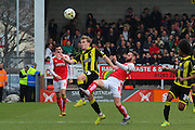 Burton Albion defender Damien McCrory and Fleetwood Town midfielder Jimmy Ryan challenge for the ball during the Sky Bet League 1 match between Burton Albion and Fleetwood Town at the Pirelli Stadium, Burton upon Trent, England on 12 March 2016. Photo by Aaron  Lupton.