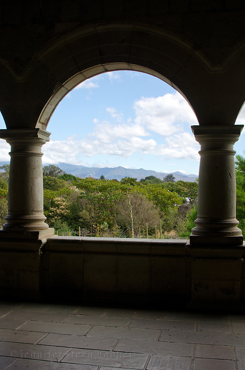 Looking through an arch in the Centro Cultural Santo Domingo over the Jardín Etnobotánico to the distant mountains.