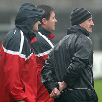 Crusheen Management Team keep a sharp eye on proceedings at the Co. Hurling Final.<br /> Photograph by Flann Howard