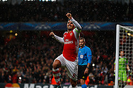 Mikel Arteta of Arsenal celebrates scoring the opening goal against R.S.C Anderlecht during the UEFA Champions League match at the Emirates Stadium, London<br /> Picture by David Horn/Focus Images Ltd +44 7545 970036<br /> 04/11/2014