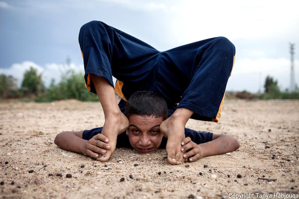 Gaza youth shows off his yogi moves.