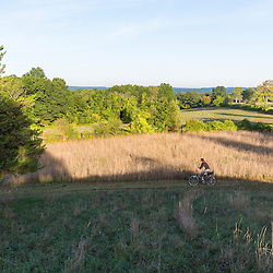 A woman biking on Sagamore Hill in Hamilton, Massachusetts.