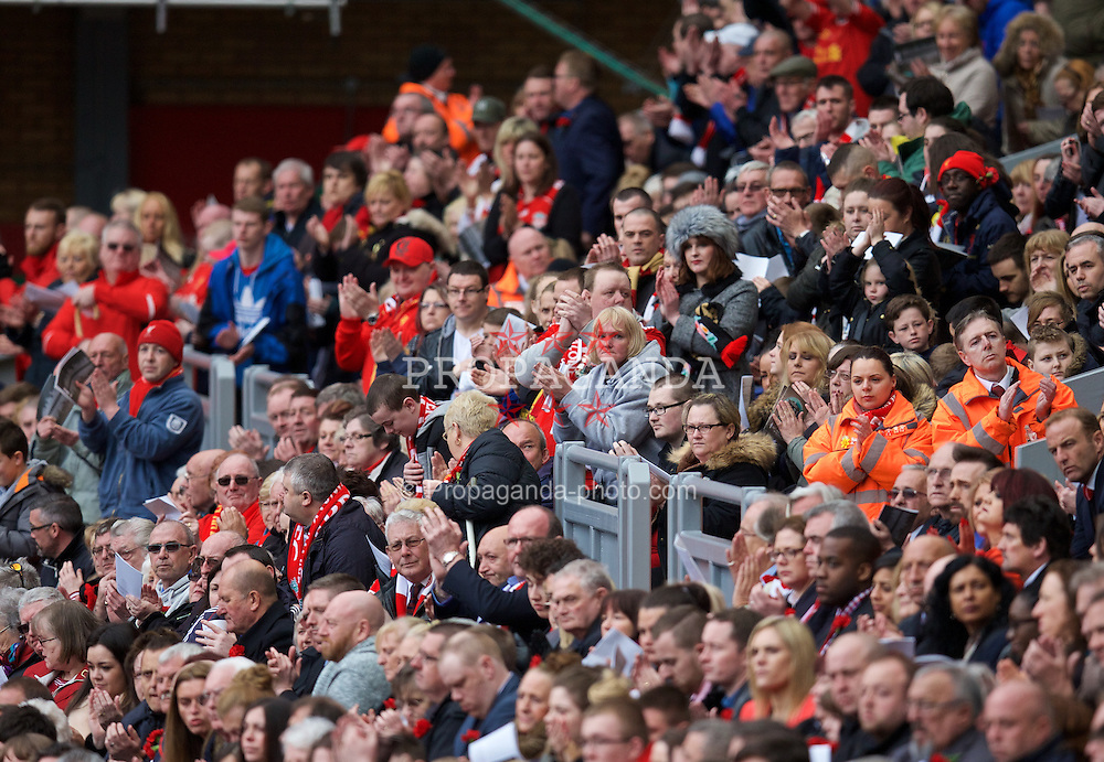 LIVERPOOL, ENGLAND - Wednesday, April 15, 2015: Liverpool supporters stand to applaud a speech by Margaret Aspinall during the 26th Anniversary Hillsborough Service at Anfield. (Pic by David Rawcliffe/Propaganda)