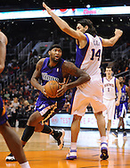 Dec. 17, 2012; Phoenix, AZ, USA; Sacramento Kings center DeMarcus Cousins (15) drives the ball during the game against the Phoenix Suns forward Luis Scola (14) in the first half at US Airways Center. Mandatory Credit: Jennifer Stewart-USA TODAY Sports.