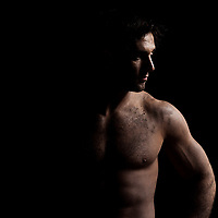 one caucasian sexy naked  man portrait handsome muscular on studio black background