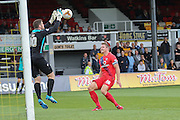 York City defender Dave Winfield watches as Newport County goalkeeper Joe Day collects the ball during the Sky Bet League 2 match between Newport County and York City at Rodney Parade, Newport, Wales on 5 September 2015. Photo by Simon Davies.