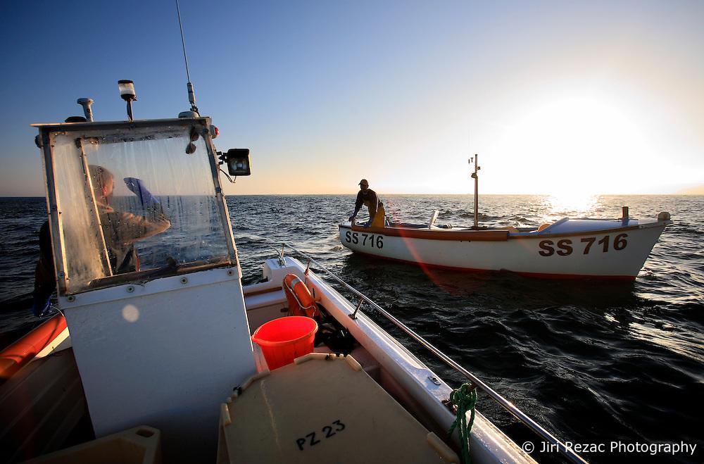 UK ENGLAND CORNWALL SENNEN COVE 11JUN08 - Cornish handline fishermen Will Treneer and Matthew Pascoe (R, in other boat) exchange news of the day's catch as they fish for Mackerel during sunrise off Sennen Cove on the southwestern coast of Cornwall, England...jre/Photo by Jiri Rezac / WWF UK..© Jiri Rezac 2008..Contact: +44 (0) 7050 110 417.Mobile:  +44 (0) 7801 337 683.Office:  +44 (0) 20 8968 9635..Email:   jiri@jirirezac.com.Web:    www.jirirezac.com..© All images Jiri Rezac 2008 - All rights reserved.