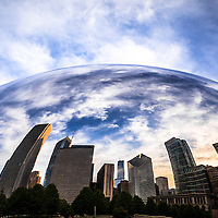 Chicago Cloud Gate The Bean sculpture with Chicago skyline reflection. The Cloud Gate sculpture was created by artist Anish Kapoor and is located in Millenium Park in downtown Chicago. Cloud Gate is also called The Bean, Chicago Jelly Bean, Silver Bean, Kidney Bean, and Giant Bean.