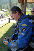 Rawhyde's ride leader Kevan Harder reviews the route on his GPS