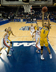 UCSB guard Jessica Wilson (5) goes up for a shot against UVA.  The #4 seed/#24 ranked Virginia Cavaliers defeated the #13 seed Santa Barbara Gauchos 86-52 in the first round of the 2008 NCAA Division 1 Women's Basketball Championship at the Ted Constant Convocation Center in Norfolk, VA on March 23, 2008