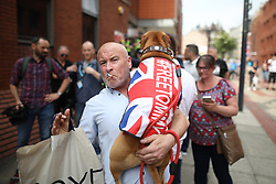 © Licensed to London News Pictures. 01/06/2018. Leeds, UK. Supporters of EDL founder Tommy Robinson ( real name Stephen Yaxley-Lennon ) demonstrate in Leeds after Robinson was convicted of Contempt of Court . Robinson was already serving a suspended sentence for Contempt of Court over a similar incident , when he was convicted on Friday 25th May 2018 . Reporting restrictions , since lifted , initially prevented coverage of Robinson's arrest and incarceration . Photo credit: Joel Goodman/LNP