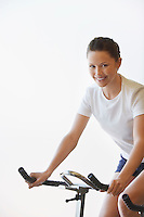 Young Woman Using Exercise Bike portrait