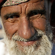 """Oman, Ra's al-Hadd. February 07/2008...An elder from the fishing village of Ra's al-Hadd. This man's generation has seen drastic changes to a country that was in a self-imposed state of international isolation before 1970. """"There's a sense of pride reflected in the faces of Oman's population - from elders in a small fishing village that enjoy universal healthcare, to the smiles of their grandchildren, for whom tertiary education is now not only free, but encouraged."""""""