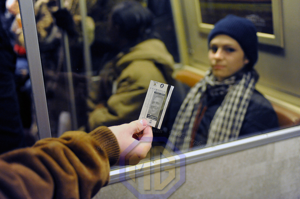 A passenger holds a commemorative Washington Metropolitan Transit Authority train ticket for the swearing in of Barack Obama as the 44th President of the United States of America during his Inauguration Ceremony on Capitol Hill in Washington on January 20, 2009.  (Mark Goldman/ Goldmine Photos)
