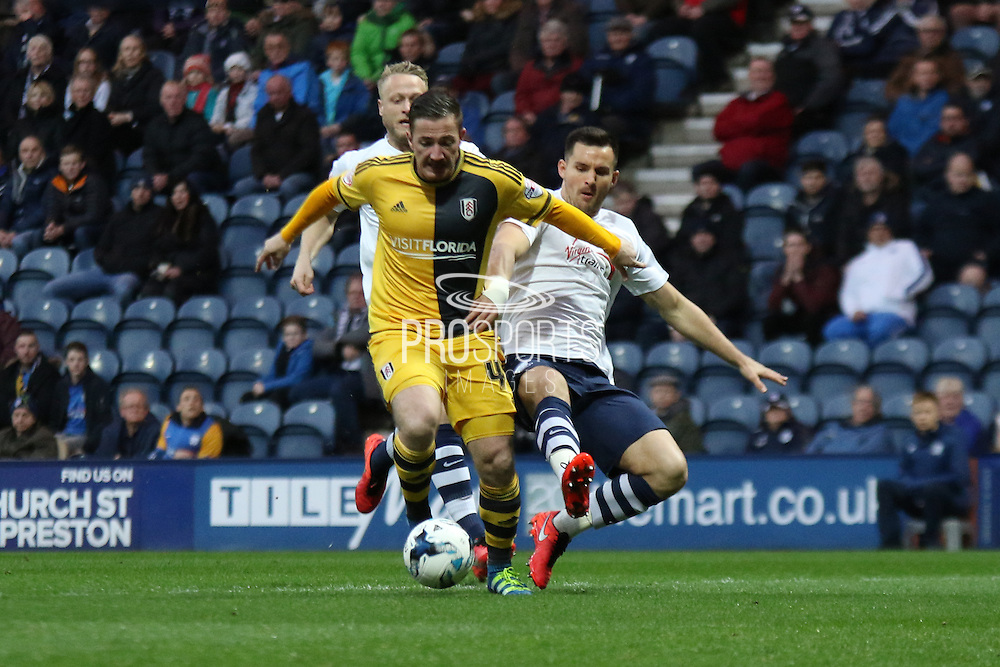 Ross McCormack and Bailey Wright battle during the Sky Bet Championship match between Preston North End and Fulham at Deepdale, Preston, England on 5 April 2016. Photo by Pete Burns.