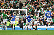 Lee McCulloch fires in a shot during the League Cup final between Rangers and Celtic at Hampden Park -<br /> David Young Universal News And Sport