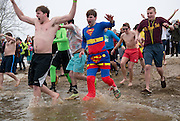 Clad in a variety of costumes, partipants in the Polar Plunge jump into the icy waters of Lake Snowden on Feb. 8, 2014. Photo by Lauren Pond