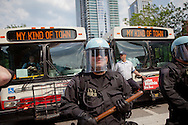 Chicago Illinois, police stand in front of city buses during anti-NATO march through Chicago led by Veterans for Peace and included Occupy Wall Street, and members of the Occupy movement from across the country.