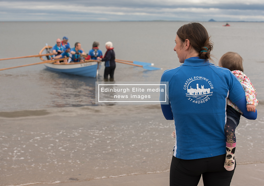 Earlier today coastal rowing teams from in and around Edinburgh gathered on Portobello beach for a rowing regatta hosted by Row Porty. Teams of young and old took part, rowing out from the beach to a line of marker bouys and back again. <br /> <br /> <br /> © Jon Davey/ EEm