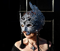 © Licensed to London News Pictures. <br /> 01/11/2014. <br /> <br /> Whitby, Yorkshire, United Kingdom<br /> <br /> Kath McDonald from Marske in Cleveland wears a silver ball mask as she attends the 20th anniversary of the Whitby Goth Weekend. <br /> <br /> The event this weekend brings together thousands of extravagantly dressed followers of Victoriana, Steampunk, Cybergoth and Romanticism who all visit the town to take part in celebrating Gothic culture. This weekend marks the 20th anniversary since the event was started by local woman Jo Hampshire.<br /> <br /> Photo credit : Ian Forsyth/LNP