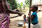 Photo Shows: <br /> Mother Rosoa Arimalala Aunorine pounding wheat outside the family home.<br /> <br /> Their home is a 3 hour walk from the nearest hospital at Anivorano Est where they can find information about  Operation Smile and find transport to the mission in Tamatave.  They were aware of Operation Smile&rsquo;s 2013 mission to Antananarivo but did not have the money to get there. They have never been to Tamatave where Operation Smile&rsquo;s 2014 mission will take place. The distance from their home to Tamatave is approximately 155 miles and the journey will take them 8 hours.<br /> <br /> Vaviroa (6) has never been to school because her parents worry that the other children will tease her. They live in a small hamlet accessible by single path over rough terrain. The nearest village is Ambodijania. Mother and Father work as subsistence farmers, mainly growing rice. Occasionally the father Dest works in a neighbour&rsquo;s field for which he earns 3000 ariarys ($1.20) per day. <br /> <br /> North East of Anivorana Est, Near Brickaville. Madagascar. <br /> 29h August 2014. <br /> <br /> (Operation Smile Photo - Zute Lightfoot)
