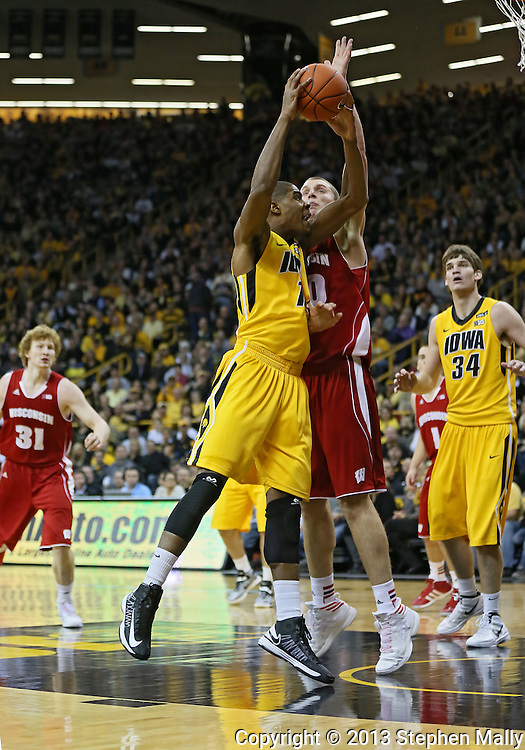 January 19 2013: Iowa Hawkeyes forward Melsahn Basabe (1) tries to shoot around Wisconsin Badgers forward/center Jared Berggren (40) during the first half of the NCAA basketball game between the Wisconsin Badgers and the Iowa Hawkeyes at Carver-Hawkeye Arena in Iowa City, Iowa on Sautrday January 19 2013. Iowa defeated Wisconsin 70-66.