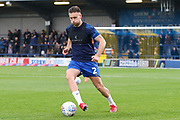 AFC Wimbledon defender Luke O'Neill (2) warming up during the EFL Sky Bet League 1 match between AFC Wimbledon and Gillingham at the Cherry Red Records Stadium, Kingston, England on 23 November 2019.