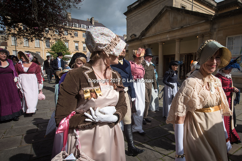 Bath, Somerset, UK. 9th September 2017. Pictured:  The Promenade passes by the Assembly Rooms in Bath centre. /  Around 600 people dressed in period attire take part in the Grand Regency Costumed Promenade in Bath marking the 200th anniversary of the English novelist Jane Austen's death. The Promenade commenced mid-morning from the world famous Royal Crescent Lawn and made its way through the historic Georgian streets and main shopping area of the city before finishing at Parade Gardens. In 2014 the Jane Austen Festival achieved the Guinness World Record TM for 'The largest gathering of people dressed in Regency costumes'. The Somerset city is currently host to the 17th annual Jane Austen Festival with an expected 4000 visitors taking part in events such as film screenings, book readings, workshops, dances, balls, talks, concerts and theatricals. // Lee Thomas, Tel. 07784142973. Email: leepthomas@gmail.com  www.leept.co.uk (0000635435)
