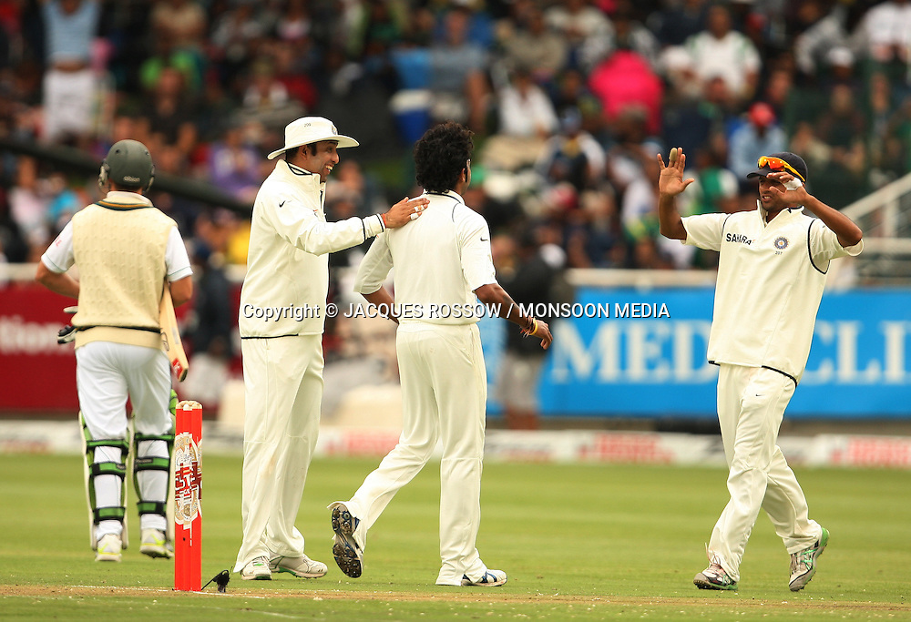 Sree Sreesanth is congratulated by VVS Laxman and Rahul Dravid after dismissing AB de Villiers during Day 1 of the third and final Test between South Africa and India played at Sahara Park Newlands in Cape Town, South Africa, on 2 January 2011. Photo by Jacques Rossouw / MONSOON MEDIA