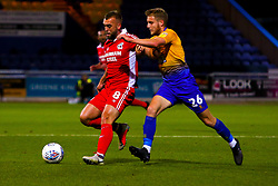 Jason Law of Mansfield Town puts pressure on James Horsfield of Scunthorpe United - Mandatory by-line: Ryan Crockett/JMP - 13/11/2018 - FOOTBALL - One Call Stadium - Mansfield, England - Mansfield Town v Scunthorpe United - Checkatrade Trophy