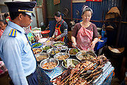 Vientiane, Laos. Food stall at morning market.