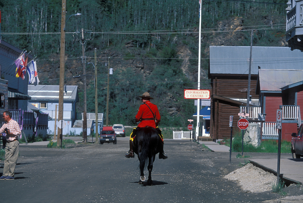 Canada, Yukon Territory, Dawson City, RCMP Constable Dan Parlee on horseback on summer morning