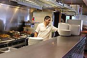 cook in kitchen making breakfast at restaurant