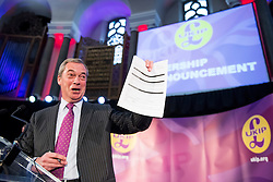 © Licensed to London News Pictures. 28/11/2016. London, UK. Former leader of UKIP, NIGEL FARAGE, holds up an Electoral Commission Form while speaking on stage ahead of the announcement of the new leader of the UK Independence Party (UKIP), at the Emmanuel Centre in Westminster London, where former deputy leader Paul Nuttall was elected the new leader.  Photo credit: Ben Cawthra/LNP