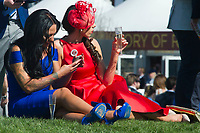 National Hunt Horse Racing - 2017 Randox Grand National Festival - Saturday, Day Three [Grand National Day]<br /> <br /> Female race goers with champagne & tattoos relaxing on a sunny day  after  the 1st race the 1.45 Gaskells Handicap Hurdle at Aintree Racecourse.<br /> <br /> COLORSPORT/WINSTON BYNORTH