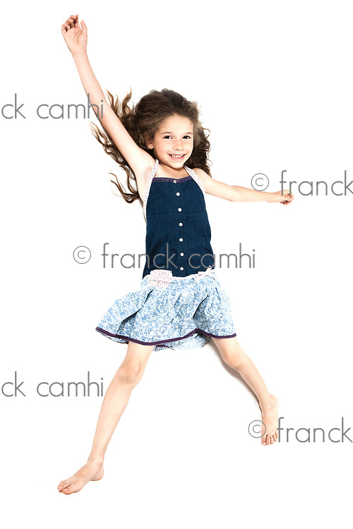 caucasian little girl laying happy isolated studio on white background