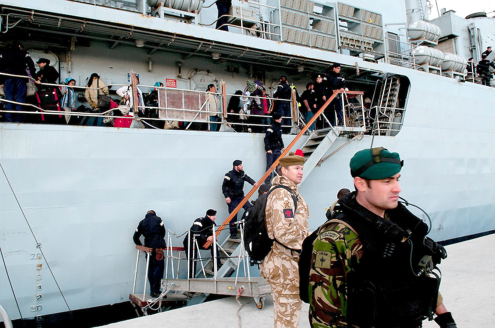 Civilians board the Ship. The HMS Cumberland docks in the Port of Benghazi in Libya to evacuate 200 people from various nations.