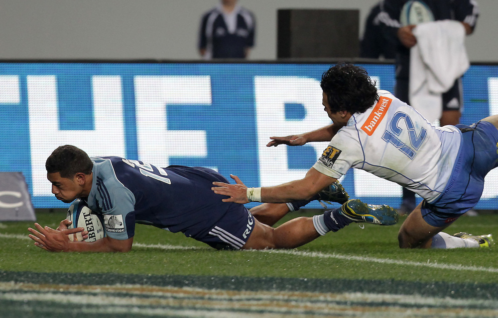 Force's Winston Stanley fails to stop Blues' Charles Piutau from scoring a try in a Super Rugby match, Eden Park, Auckland, New Zealand, Saturday, July 07, 2012.  Credit:SNPA / David Rowland