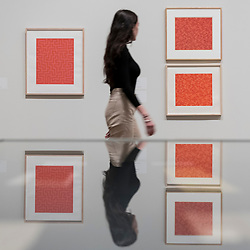 "© Licensed to London News Pictures. 09/10/2018. LONDON, UK. A visitor walks by screen prints and studies for ""Red Meander I"", 1969-70 and ""TRI"", 1969-70, by Anni Albers.  Preview of the UK's first exhibition of works by German artist Anni Albers at Tate Modern who used the ancient art of hand-weaving to produce works of modern art.  Over 350 of her artworks from major collections from Europe and the US are on show 11 October to 27 January 2019.  Photo credit: Stephen Chung/LNP"