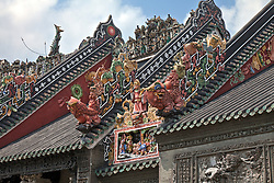 "Roofing art detail, The Chen Clan Ancestral Hall in Guangzhou, China. Built by the 72 Chen clans for their juniors' accommodation and preparation for the imperial examinations in 1894 in Qing Dynasty, it now houses the Guangdong Folk Art Museum and is a symmetric complex consist of 19 buildings with nine halls and six courtyards.  A large collection of southern China art pieces stud all portions of the building.  It was added in the list of ""Cultural Relics of National Importance under the Protection of the State"" in 1988."