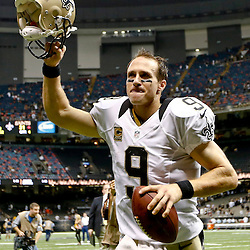 Sep 22, 2013; New Orleans, LA, USA; New Orleans Saints quarterback Drew Brees (9) celebrates after a win over the Arizona Cardinals during a game at Mercedes-Benz Superdome. The Saints defeated the Cardinals 31-7. Mandatory Credit: Derick E. Hingle-USA TODAY Sports