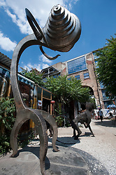 Modern art sculptures at art outdoor art gallery at Tacheles art workshop space on Oranienburger Strasse in Berlin Germany